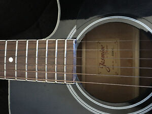 Jasmine by Takamine black guitar with hard shell case and tuner