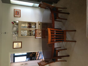 Antique 2 leaf table with 4 newer chairs