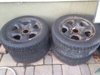 4 good condition snow tires with rims
