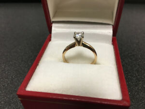 Bague en or 14kt ave solitaire 0,40ct