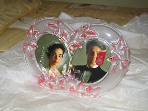 Beautiful glass picture frame with 2 openings for photos