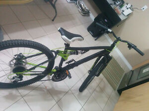 Moving sale - Full suspension CCM Mountain bike and Lady Helmet