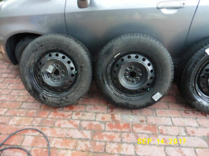 Used P215-60R16 Michelin X-Ice Winter tires on rims and hubcaps