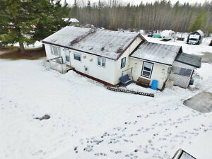Renovated 2 bed 2 bath home priced to sell on 1 acre!