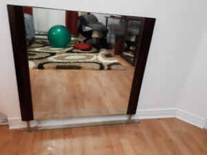 Mirror in  wood frame, with glass shelfand and with chrome legs
