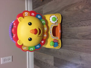 Fisher price sit, stride and ride lion