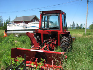 Tractor for sale, with snowblower.