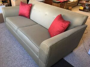 Olive green fabric sofa