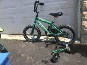 Kid's bike with removable training wheels.