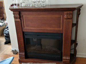 Wood mantle with built in electric fire place, omits heat