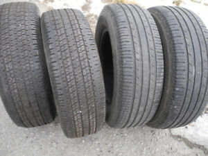 Set of four tires, two Michelins - P215/70R16. M+S all-seasons.