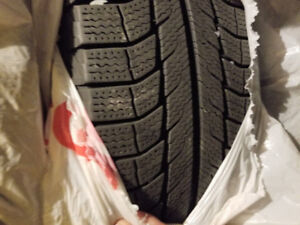 Selling 4 215/70/16 Michelin X-ice tires and rims