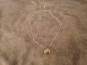 Silver and carved natural crystal necklace $15