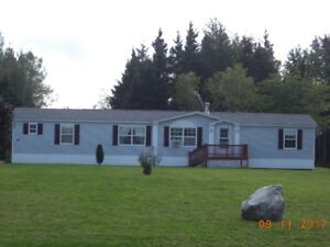 2002 Maple Leaf Mini Home for sale by owner. Must be moved!