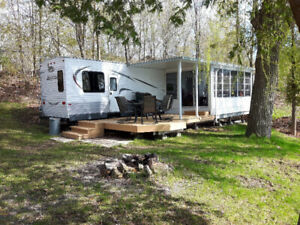 Waterfront trailer with private dock.