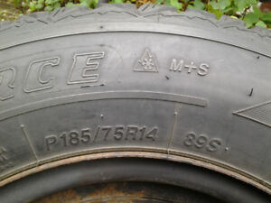 4 Firestone snow tires, 185/70/R14, on steel rims, lots of tread