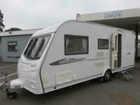 2011 COACHMAN VIP 520-4, 4 BERTH CARAVAN WITH SIDE DINETTE AND REAR WASHROOM....