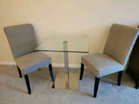 SOLD - Glass table and 2 grey chairs