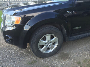 Ford Factory 5 spoke rims with tires.