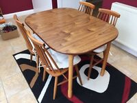 Solid wood extending dining table with 4 chairs in mint condition no marks!