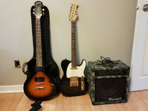 2 electric guitars and an amp package deal