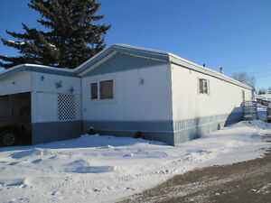 Well Kept 1981Mobile Home with 20x30 addition and carport.