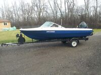 Outboard Thundercraft Boat with trailer.