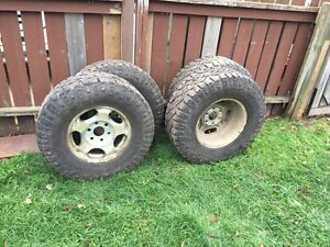 Wrangler duratrac Goodyear tires with rims