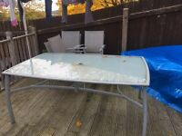 Large glass table and 6 chairs