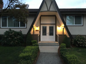 3 Bedroom 1400 sq ft Bsmt suite with garage and utilities includ