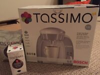 Tassimo coffee brewing system + 2 free pack of coffee