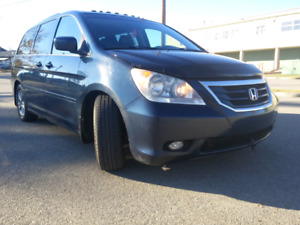 2010 Odyssey touring. 8 seats. fully fully loaded with DVD