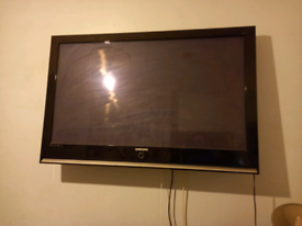 """Samsung 52"""" TV with remote and TV bracket for wall (no stand)"""