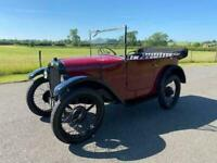 1929 Austin Seven Chummy in Maroon with black interior and black hood.