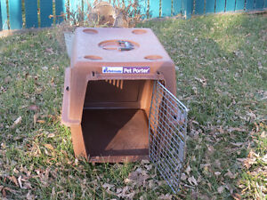 $25 · REDUCED! AGAIN. PLASTIC DOG CRATE