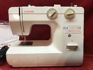 Machine coudre singer 1120 autre laval rive nord for Machine a coudre kijiji