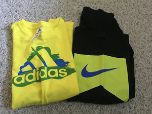 Black nike t- shirt and yellow adidas