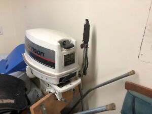 20 hp Johnson outboard motor, 2 stroke with tank and hose