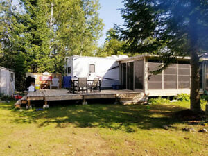 2012 Jayco 36' Trailer with sunroom and deck package