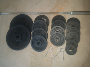 255lbs York Olympic weight plates with heavy duty bar and bench