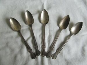 FIVE SILVER PLATE GRAPEFRUIT EATING SPOONS