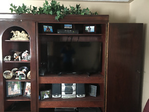 Antique armoire changed into T.V unit