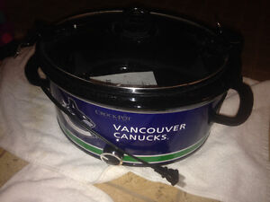Brand new never used Canucks slow cooker and manual