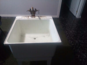 Laudry tub with taps