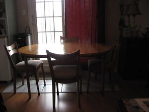 Excellent solid wood dining set , made in Canada