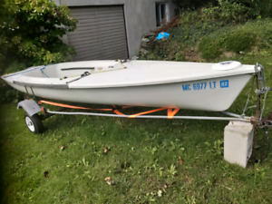 Laser 2 sailboat with trailer