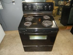 Black coil top stove $125.Whirlpool black dishwasher $50