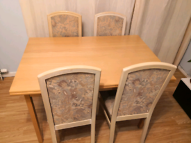 Extended dining table with 4 chairs