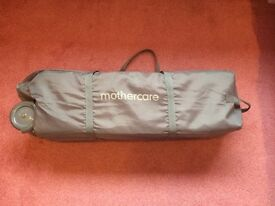 Travel Cot from Mothercare with mattress.