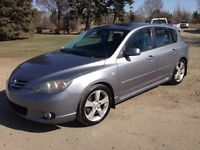 2005 Mazda Mazda3, GT-Pkg, 5/spd, loaded, roof, clean, $3,750